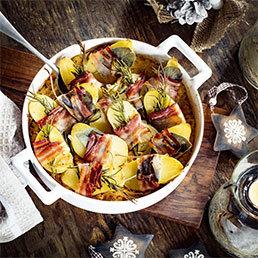 Überbackene Speck-Kartoffeln auf Rahm- Sauerkraut