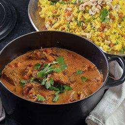 Lamm-Curry mit Biryani Reis und Raita